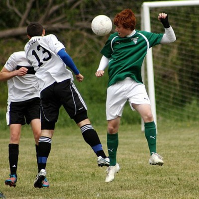 Liam Romond (in green) playing for the VTSA soccer team. (Photo by Linda Kennington).